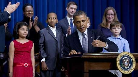 President Barack Obama, accompanied by Vice President Joe