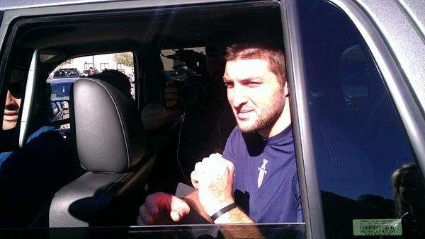 Jets quarterback Tim Tebow leaves a workout in