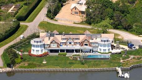 This waterfont mansion in Water Mill is on