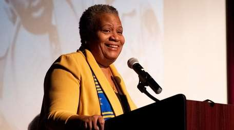 Tracey Edwards speaks at an interfaith celebration in
