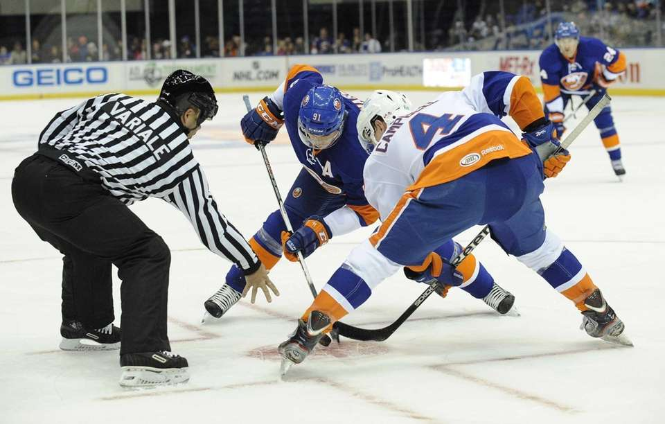 Islanders' John Tavares faces off with Scott Campbell