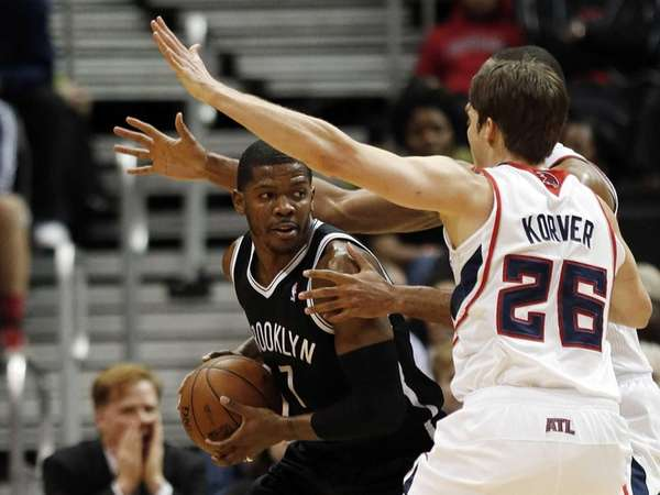 Brooklyn Nets shooting guard Joe Johnson is covered