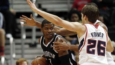 Brooklyn Nets shooting guard Joe Johnson is covered