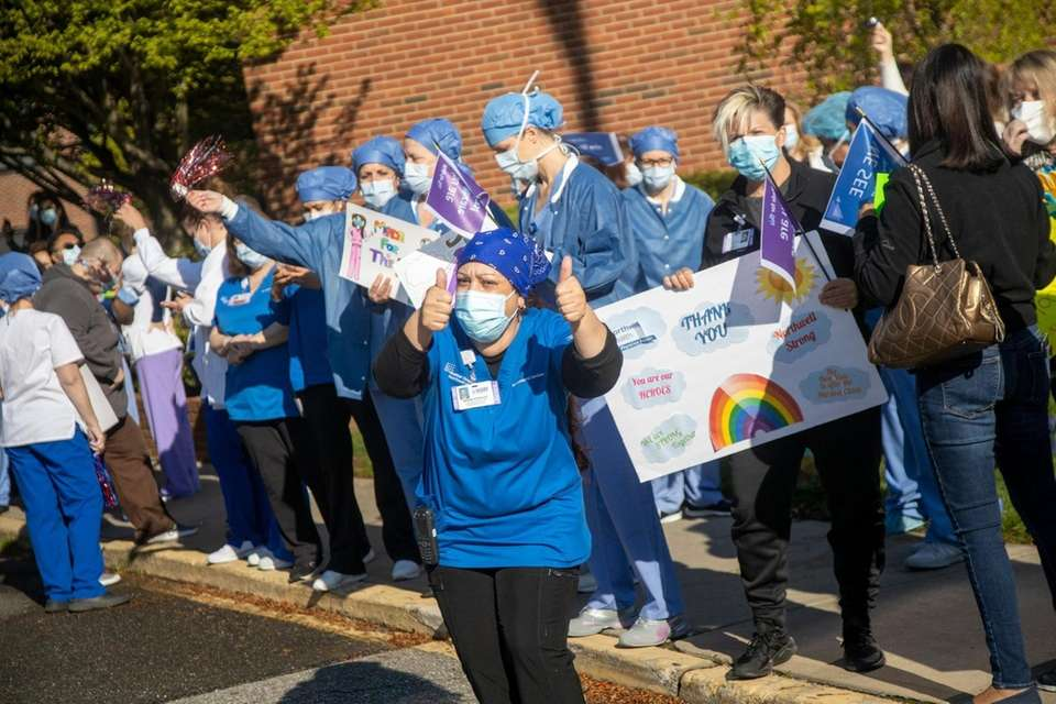 Healthcare workers clap out and dance as shift