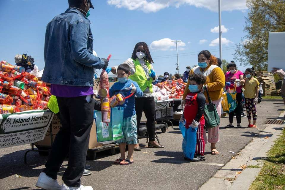 Residents receive food at a distribution area where