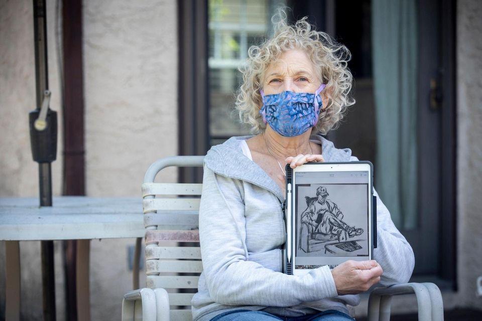 Naomi Grossman of Rockville Centre shows her sketches
