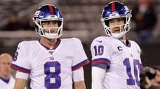Giants quarterbacks Daniel Jones, left, and quarterback Eli