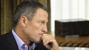 Lance Armstrong listens to a question from Oprah