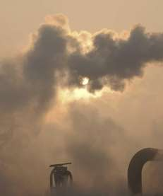 Smoke is emitted from chimneys of a cement