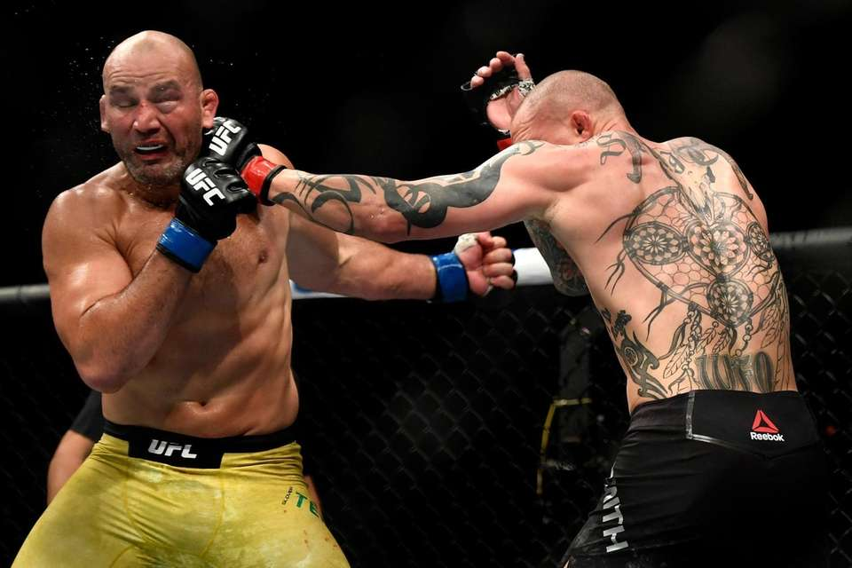 Glover Teixeira (L) of Brazil fights Anthony Smith