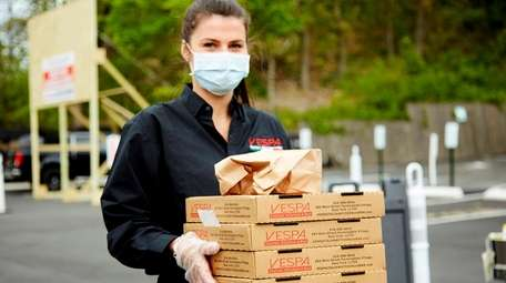 Server Magdalena Krasuska brings out a pizza order