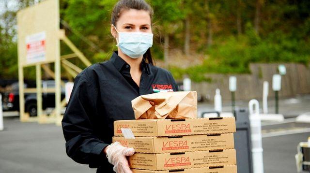 Server Magdalena Krasuska brings out a pizza order