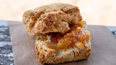 A buttermilk biscuit with orange marmalade from Main