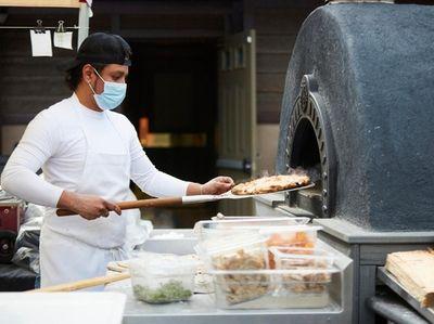 Pizza maker Steve Villalobos makes a margherita pizzette