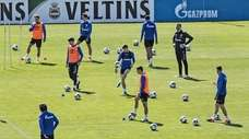 Players of Bundesliga soccer club Schalke 04 exercise