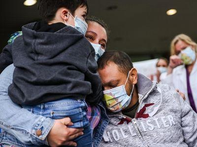 Nelson Maldonado, of Central Islip, recieves a hug