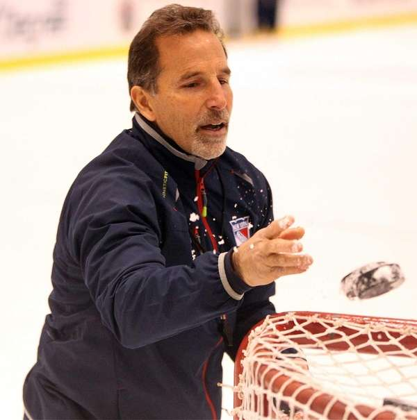 John Tortorella looks on during practice at the