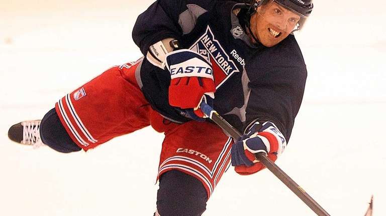 Brad Richards looks to shoot during practice at