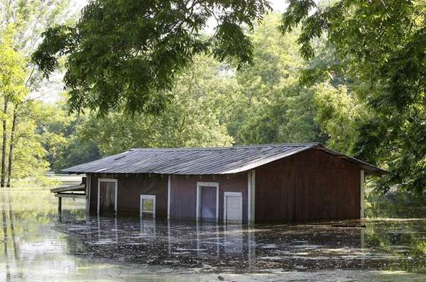 A partially-flooded building on the banks of the