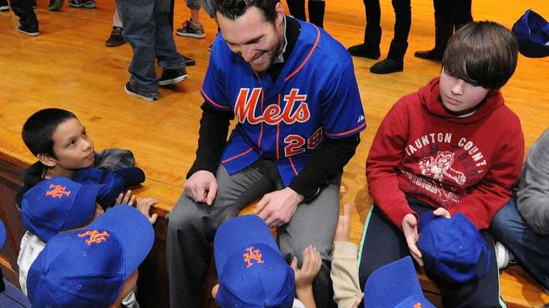 Daniel Murphy greets Long Beach students during a