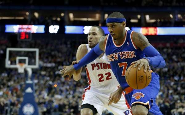 Knicks forward Carmelo Anthony, right, tries to take