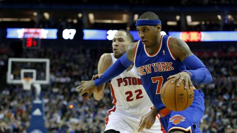 Knicks forward Carmelo Anthony, right, tries to take