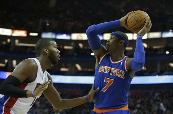 Carmelo Anthony, right, looks to get a pass
