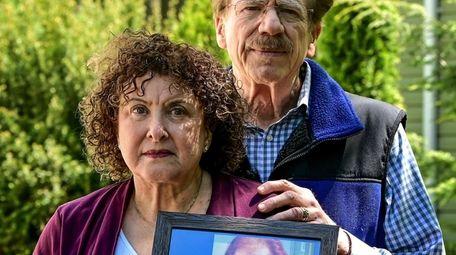 Madelynn Schwarz and her husband, Tom, holding a