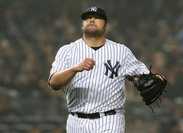 Joba Chamberlain walks off the field during a
