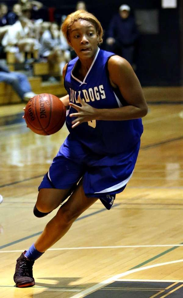 North Babylon's Makeda Nicholas drives into the paint