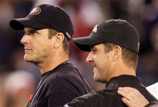 San Francisco 49ers head coach Jim Harbaugh, left,