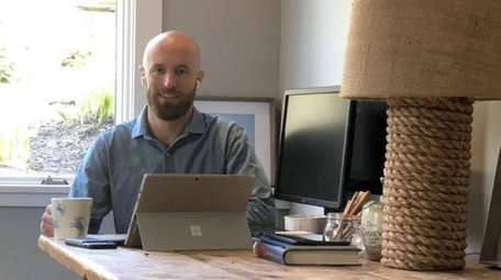 Real estate agent James Keogh works at home