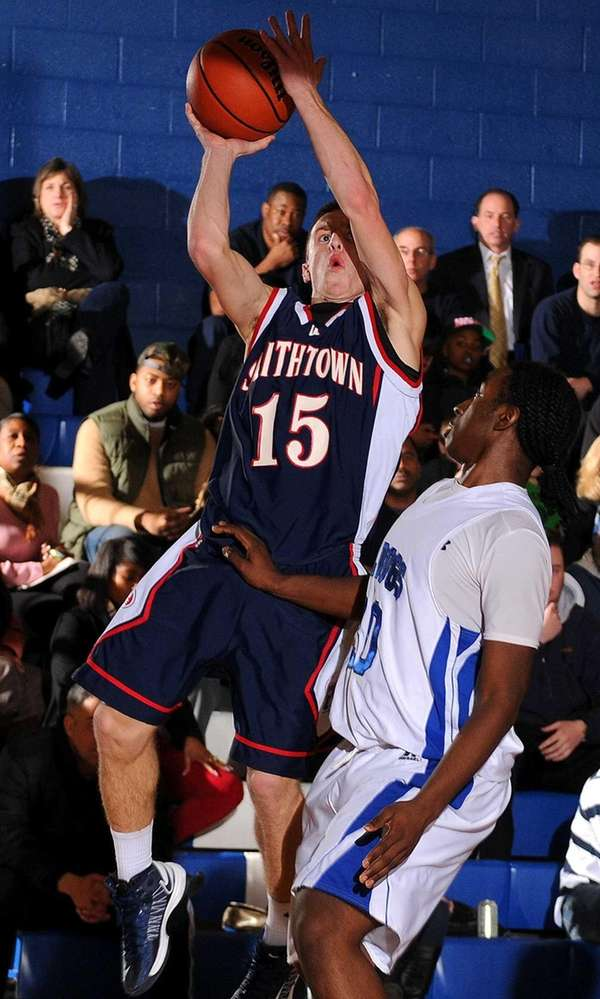 Smithtown West guard Ryan Hickey, left, looks to