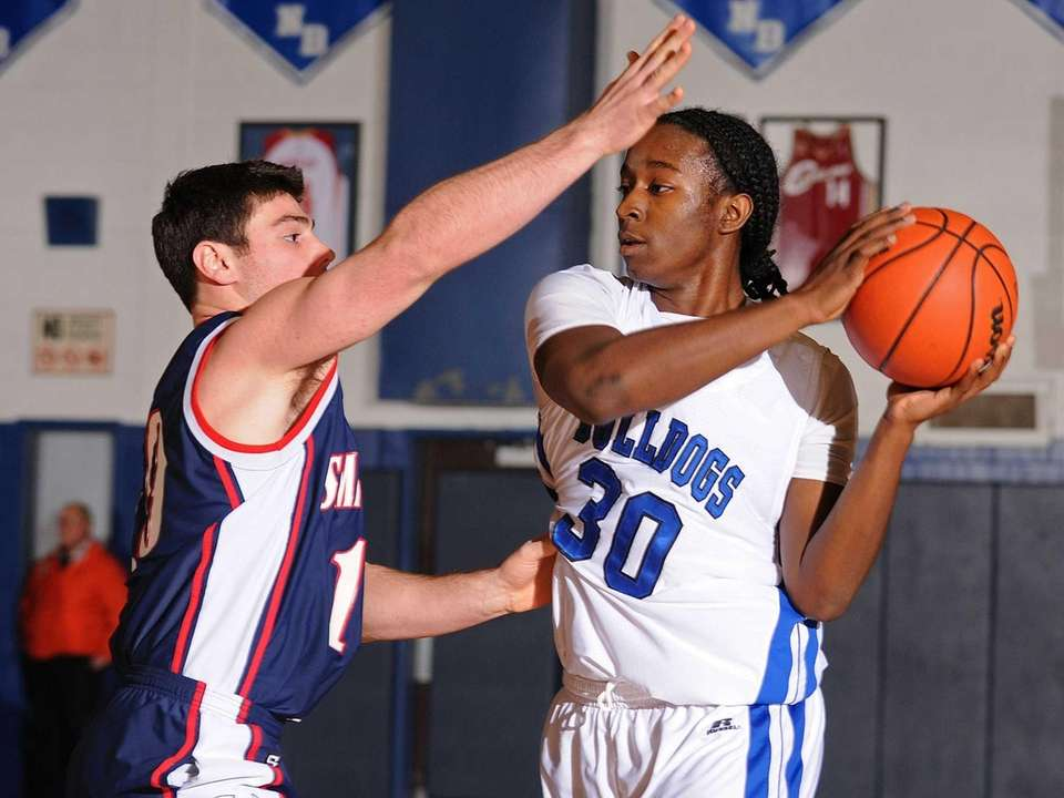 North Babylon's Melshawn McPherson, right, looks to pass