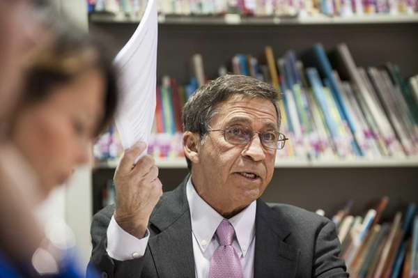 Montauk School Superintendent Jack Perna holds up a