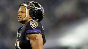Baltimore Ravens linebacker Brendon Ayanbadejo watches the action