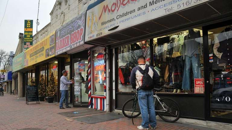 People visit some of the businesses on Hempstead