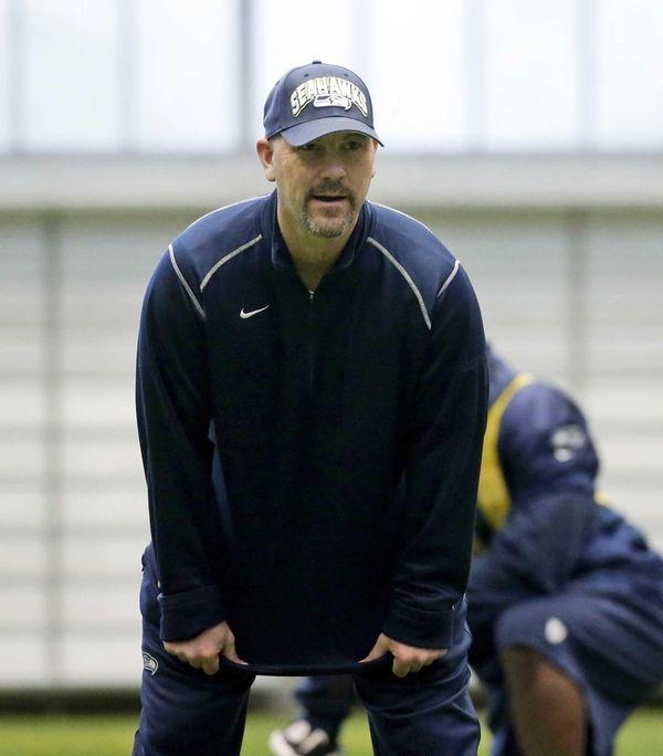 Seattle Seahawks defensive coordinator Gus Bradley watches his