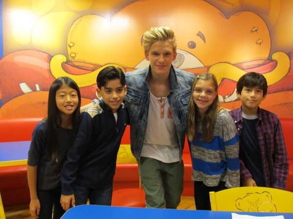 Singer Cody Simpson with Kidsday reporters Kian Ghazvini,