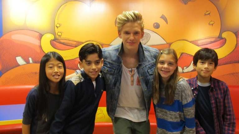 Singer Cody Simpson with Kidsday reporters Kian Ghazvini,