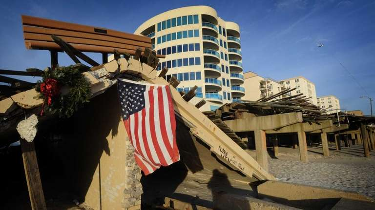 An American flag flies from a destroyed section