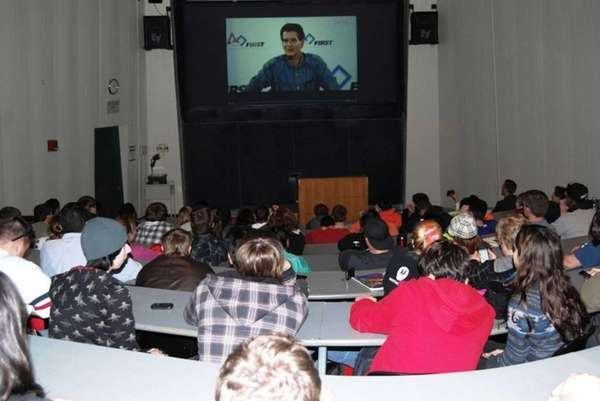 Local students view a NASA transmission of robotics