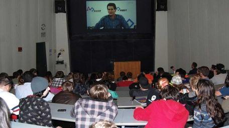Local students view a NASA transmission of robotics