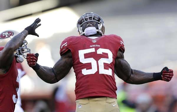 San Francisco 49ers linebacker Patrick Willis celebrates with