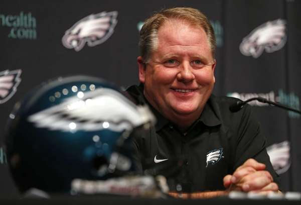 Chip Kelly talks to the media after being