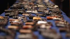 A table of illegal firearms confiscated in a