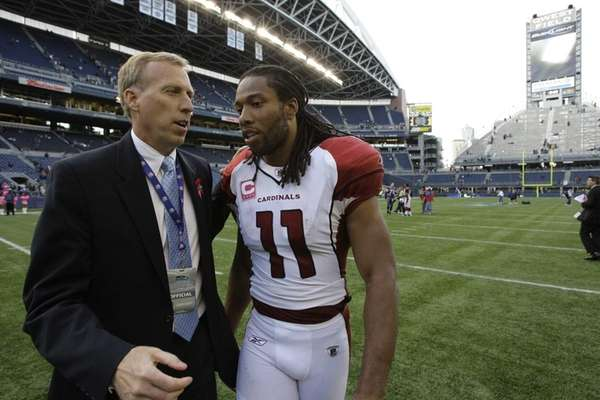 Arizona Cardinals' Larry Fitzgerald, right, chats with John