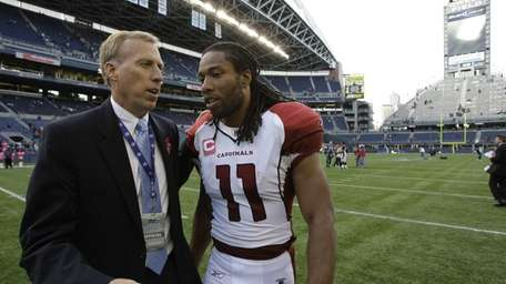 Arizona Cardinals' Larry Fitzgerald, right, chats with John