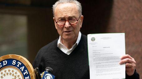 Sen. Chuck Schumer holds a warning letter sent