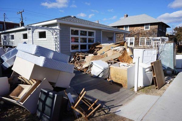 Large piles of debris still sit on the